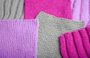 Samples of knitted tension squares arranged