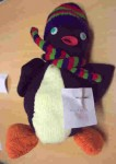 knitted penguin with stripey scarf